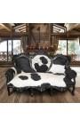 Canapé baroque vrai peau de vache noir et blanc avec bois laqué noir