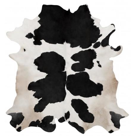 Tapis en vrai peau de vache noir et blanc for Tapis peau de vache avec canapé vert 2 places