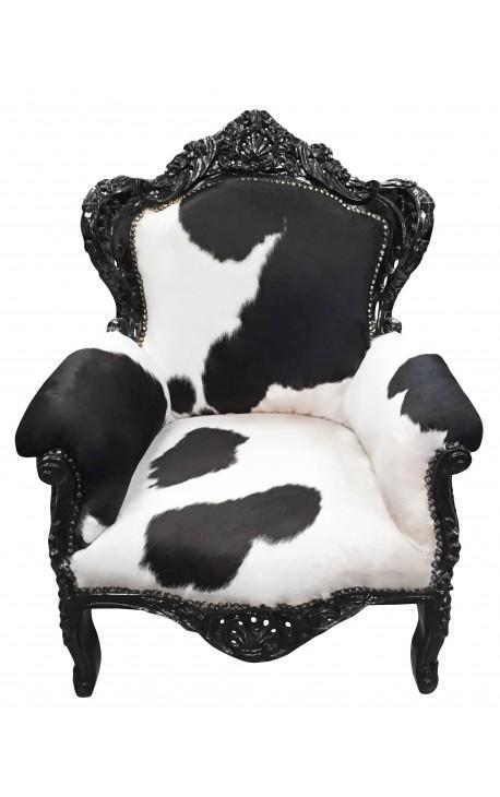 Grand fauteuil de style baroque en vrai peau de vache et bois laqué noir