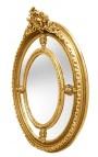 Grand miroir ovale doré baroque de style Louis XVI