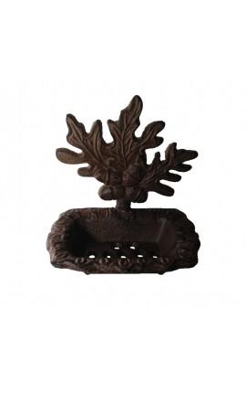 Porte savon au décors de feuillage de chêne, en fonte de fer.