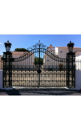 Gate for castle, baroque wrought iron gates with two doors two columns with lanterns top