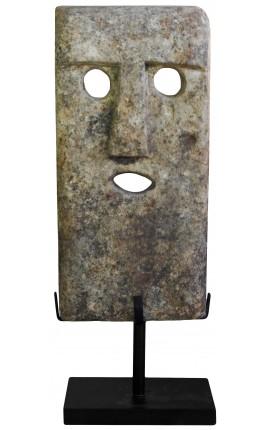 Grande sculpture de masque en pierre sur socle