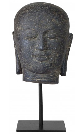 Buddha head sculpture mounted on a metal stand