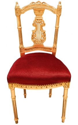 Harp chair with a burgundy velvet and gold wood