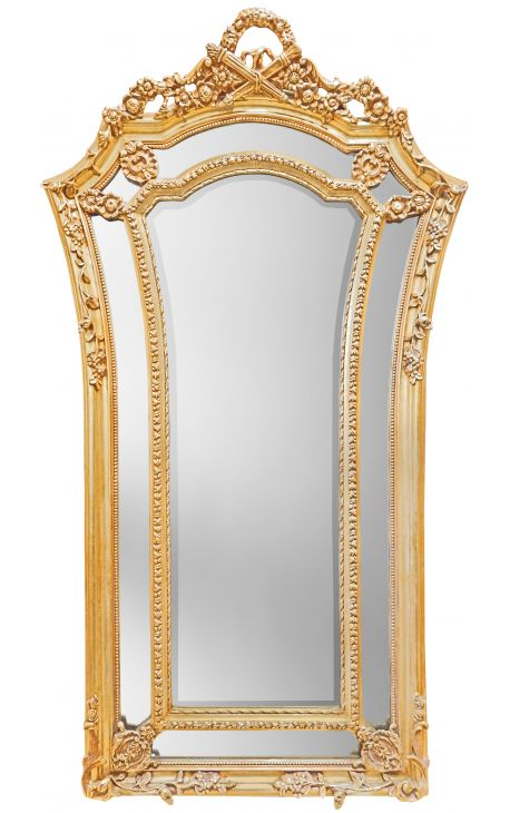 Very large gilt baroque mirror in Louis XVI style flared