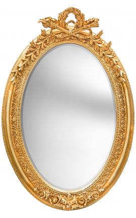Very large golden vertical oval baroque mirror