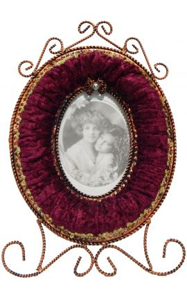 Oval photo frame with decorations in Burgundy fabric