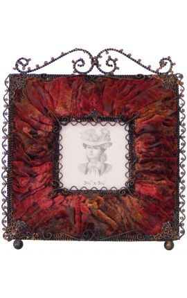 Square photo frame with decorations in burgundy fabric