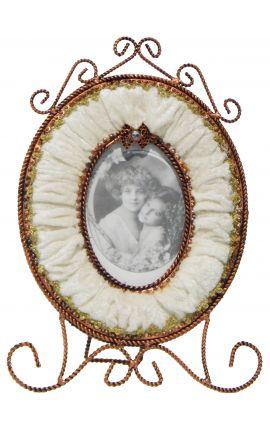 Cadre photo ovale avec décor en velours beige
