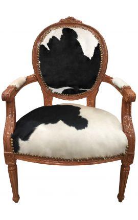 Fauteuil Louis XVI de style baroque vraie peau de vache noire et bois naturel
