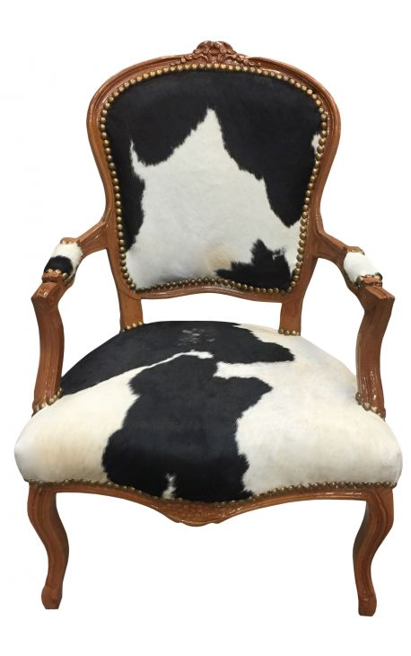 Baroque armchair of Louis XV style with real black and white cowhide and raw wood