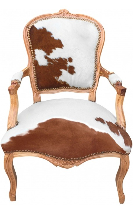 Baroque armchair of Louis XV style with real brown and white cowhide and raw wood