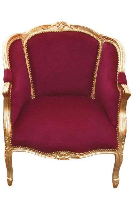 Grande bergère de style Louis XV tissu velours bordeaux et bois doré