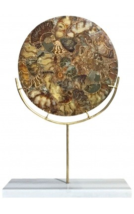 Large brown decorative disc with ammonites on a gold stand and white marble