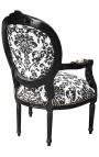 Fauteuil Louis XVI de style baroque tissu motifs floraux noir et bois noir