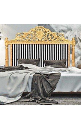 Baroque bed headboard with black and white striped fabric and gilded wood