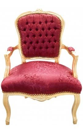 Fauteuil Louis XV de style baroque tissu satiné rouge dossier capitonné et bois doré