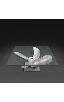 """Table basse carrée """"Helix"""" en aluminium et acier couleur argenté avec plateau en verre"""