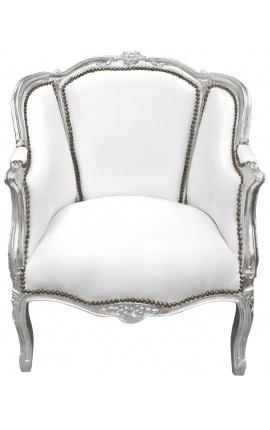 Grande bergère de style Louis XV tissu simili cuir blanc et bois argenté