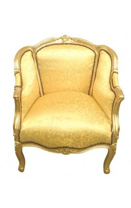 Grande bergère de style Louis XV tissu doré satiné et bois doré