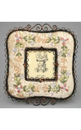 Square photo frame with decorations in beige fabric with embroidery