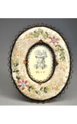 Oval photo frame with decorations in beige fabric