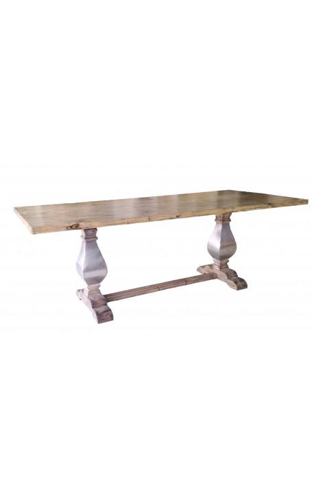 Grande table de ferme en bois naturel avec piètement balustre en inox
