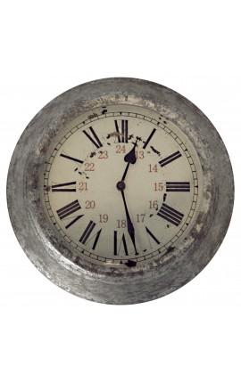 Horloge ronde murale décors zinc