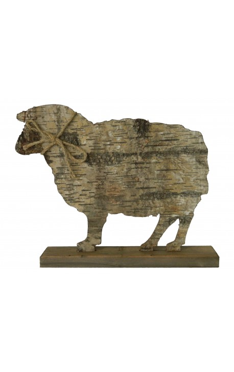 Sheep on wooden stand with bark and knot rope