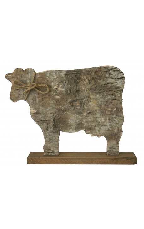cow on wooden stand with bark and knot rope