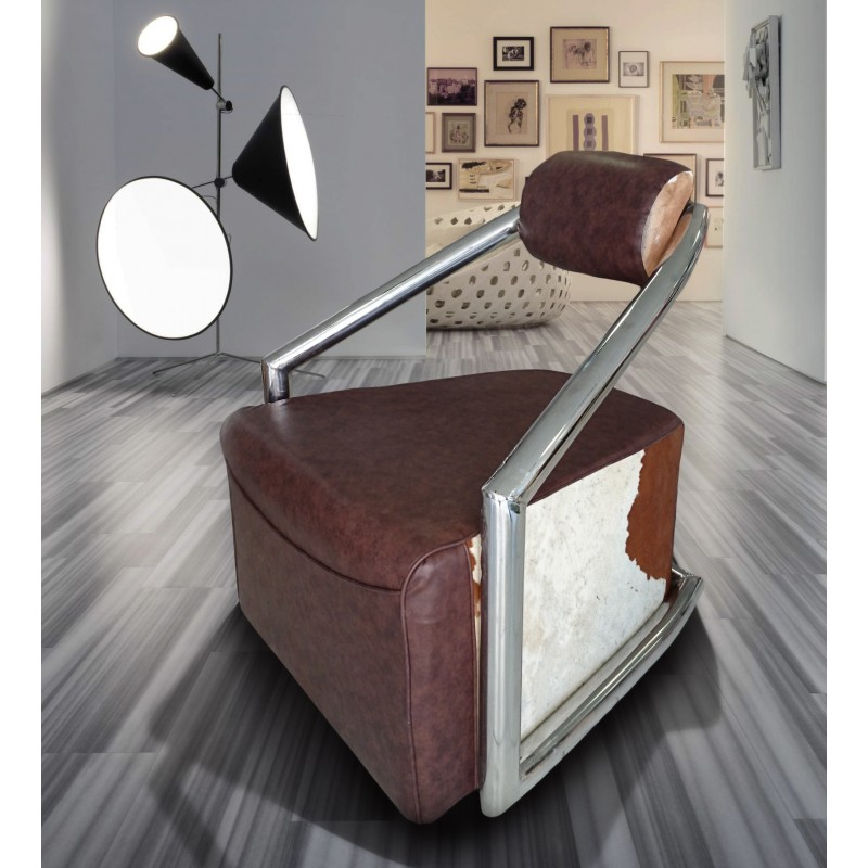 fauteuil design tubulaire en inox avec peau de vache. Black Bedroom Furniture Sets. Home Design Ideas