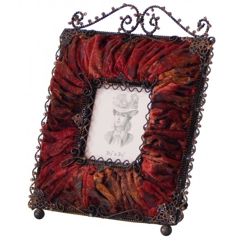 Square photo frame with decorations in red burgundy fabric