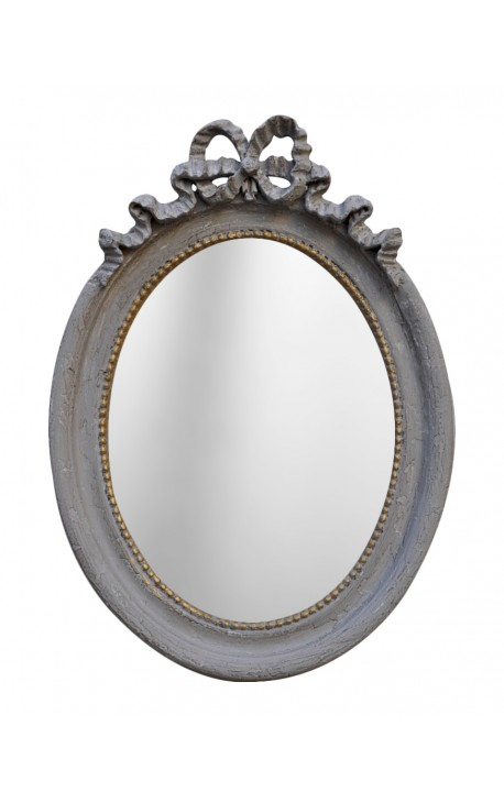 Vertical oval mirror Louis XVI grey patinated
