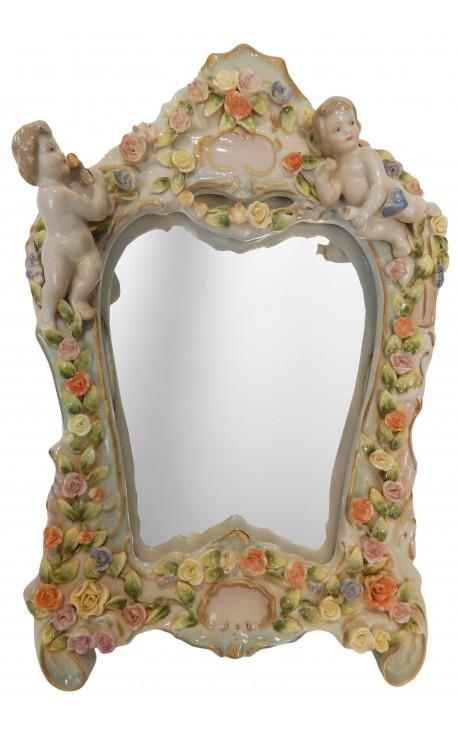 miroir en porcelaine poser avec angelots. Black Bedroom Furniture Sets. Home Design Ideas