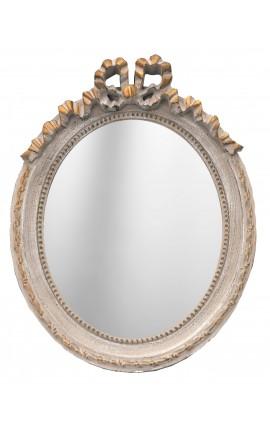 Miroir ovale vertical de style Louis XVI patiné gris et doré
