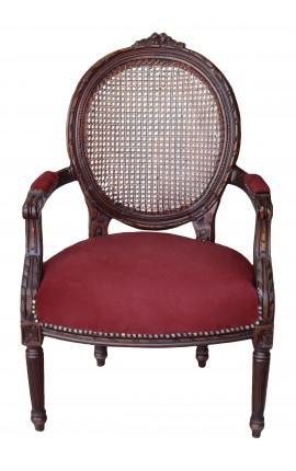 Fauteuil de style Louis XVI canné, velours bordeaux et bois acajou